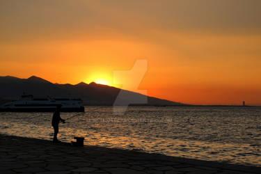 Sunset Behind to Fisherman