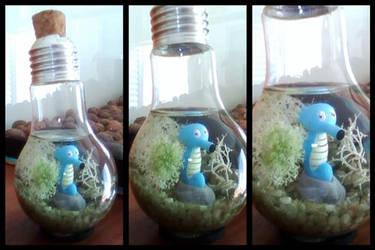 Horsea inside a light bulb