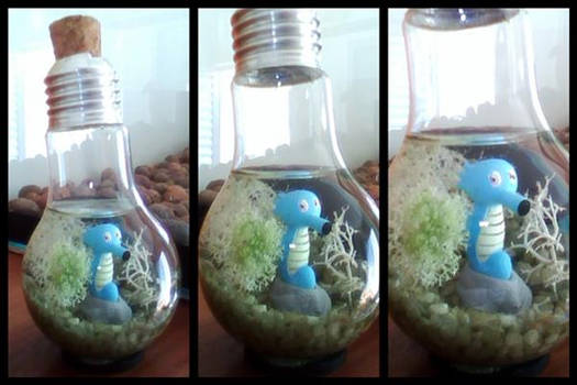 Horsea inside a light bulb