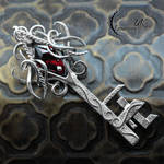 XANTHARIN - Silver and Red Zircon