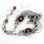 AXEMMENTH Silver, Red zirconia, Garnet