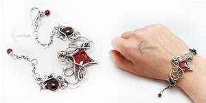 ELIVERTALX Silver, Red Zirconia and Garnets