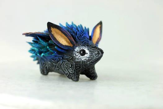 Winged hedgehog totem
