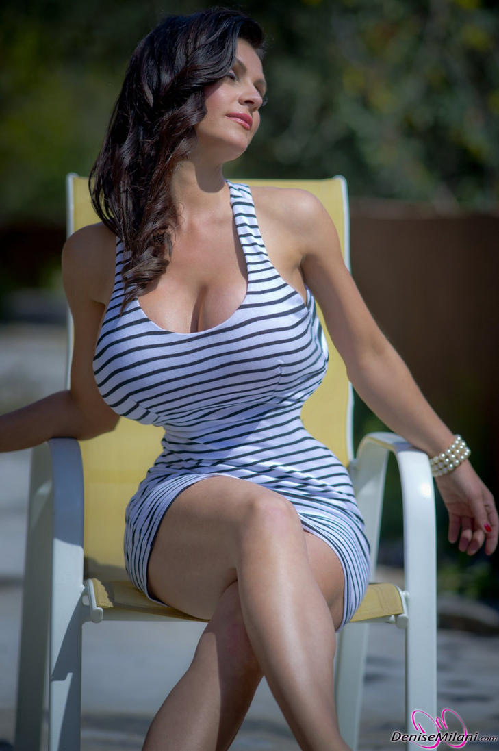 Denise sitting by cribinbic