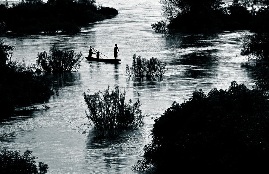 Silhouettes on the Mekong by Phoenixstamatis