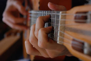 hands that finger the guitar by jampura