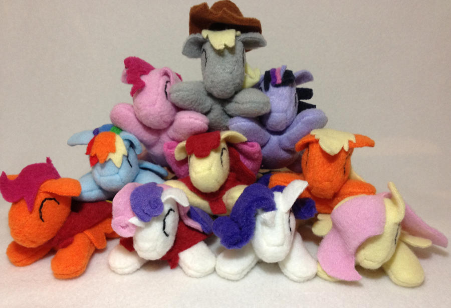 Pocket size pony pile by Bewareofkitty