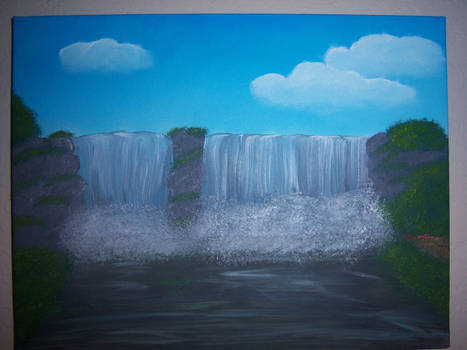 Waterfall under clouds