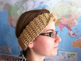 A warm golden Moebius head band