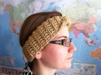 A warm golden Moebius head band