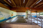 Abandoned pool with slide for children by FrXaSc