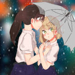 Two girls under umbrella