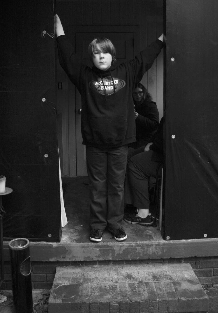 Boy in doorway by jwebbermedia