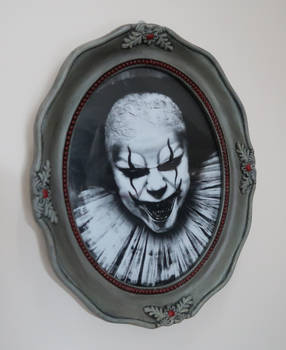 Pennywise in a frame.