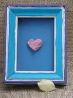 stone heart in frame by eddiebadapples