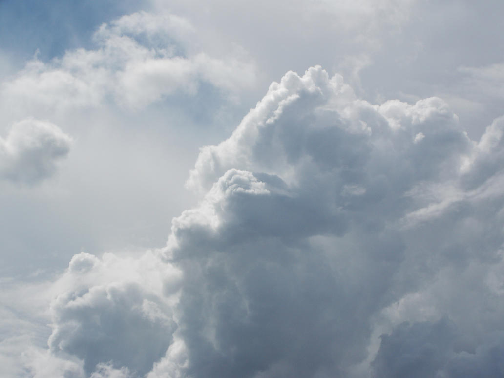 White Fluffy Clouds by GrahamSym