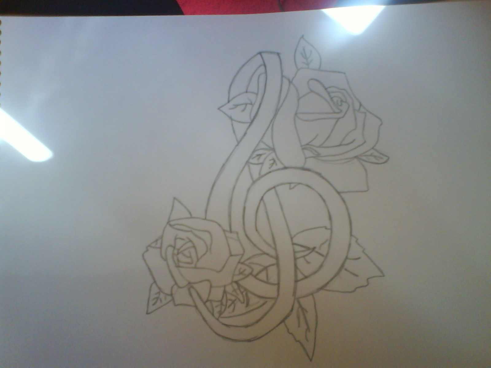 Music symbol and roses tattoo by PLAISTOWKIDD