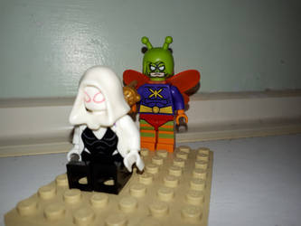 Killer Moth sneaks up on Spider-Gwen by Dreddzilla