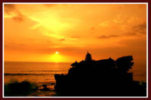sunset in tanah lot by indonesia