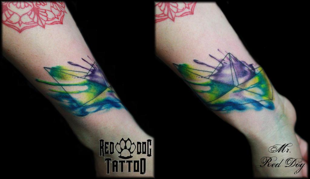 Watercolor paper boat tattoo by Reddogtattoo