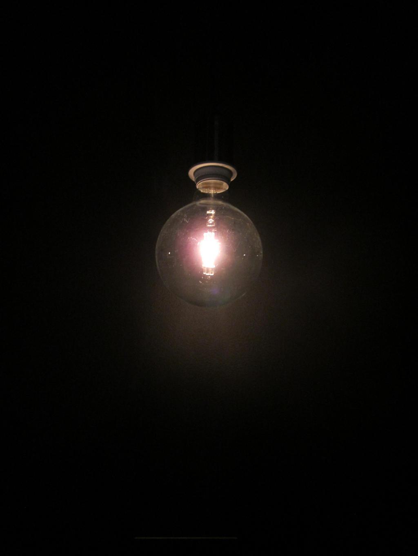 Dark room with light bulb -
