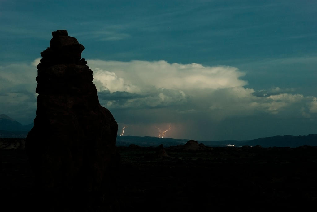 Distant Lightning at Arches National Park by Bawwomick