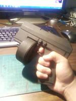 Drum-fed auto-pistol by Waileem