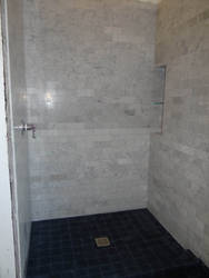 shower with marble and mexican tile