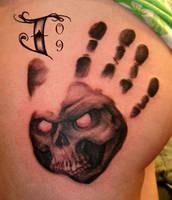 Skull hand print by jacksonmstattoo