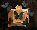 Morphee Jewelry Logo Book Sculpture