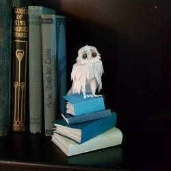 Miniature Owl on Books