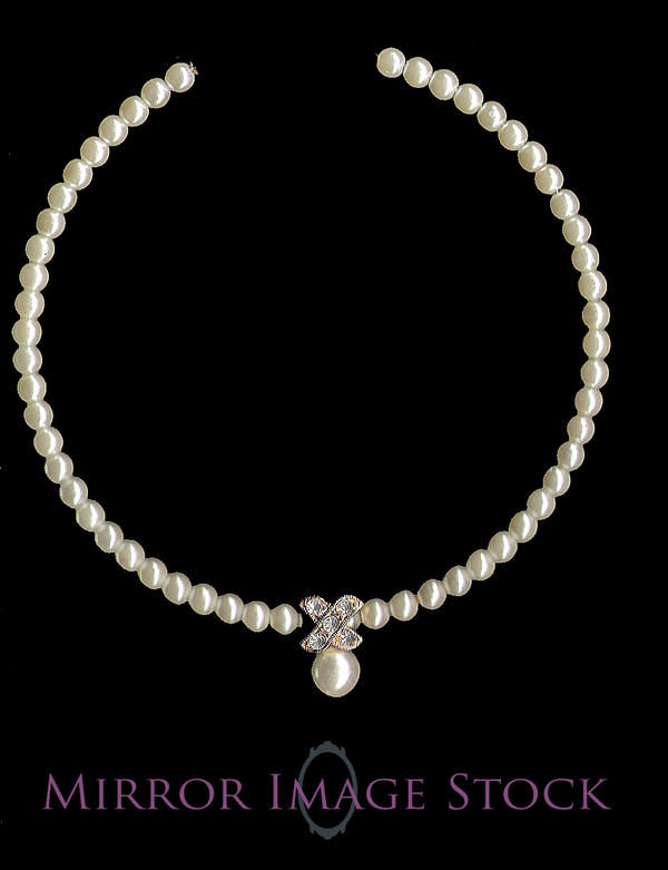 Pearl and Diamond Necklace by mirrorimagestock