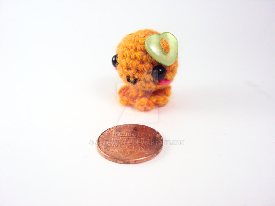 Mini Amigurumi Octie with Green Heart Button by altearithe