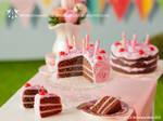 Miniature birthday cake with cherries
