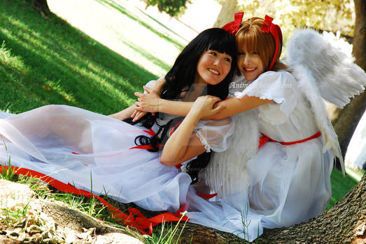 Angels Hug Sit by Tree