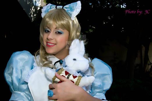 Alice holding white rabbit