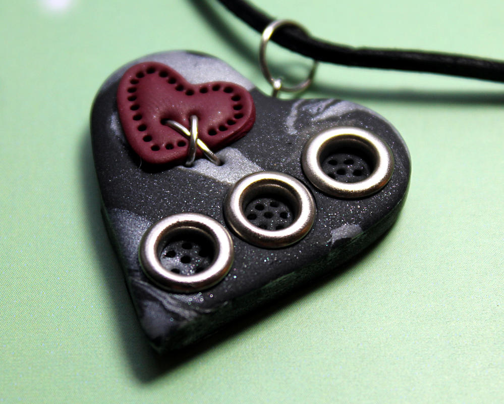 Patched heart necklace by Sakiyo-chan