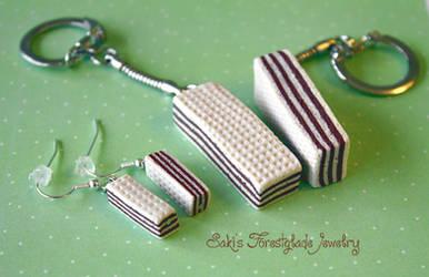 Mannerschnitten earrings and keychain by Sakiyo-chan