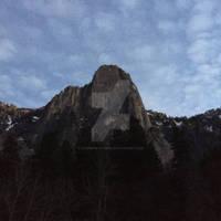 Sentinel Rock with a Pop Corn Sky