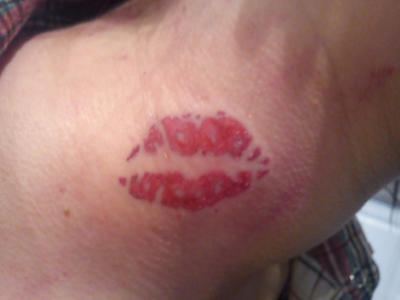 Tattoo on lips neck red The Hidden