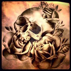 Skull rose top sleeve tattoo