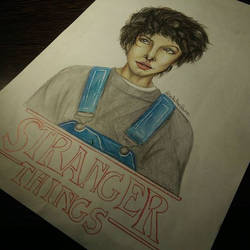 Eleven drawing Stranger Things
