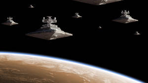 Imperial Star Destroyers above the planet