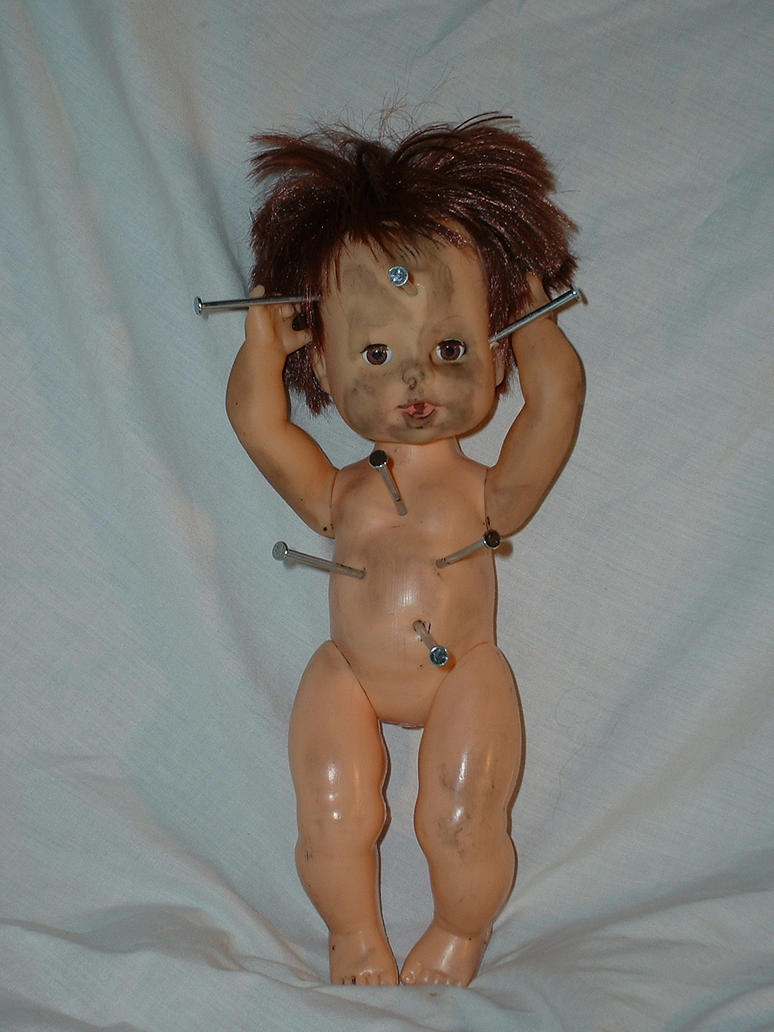 Doll with nails in head by JensStockCollection