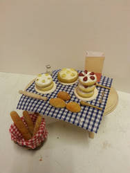 Cakes and Bread on Display by Louisetheanimator