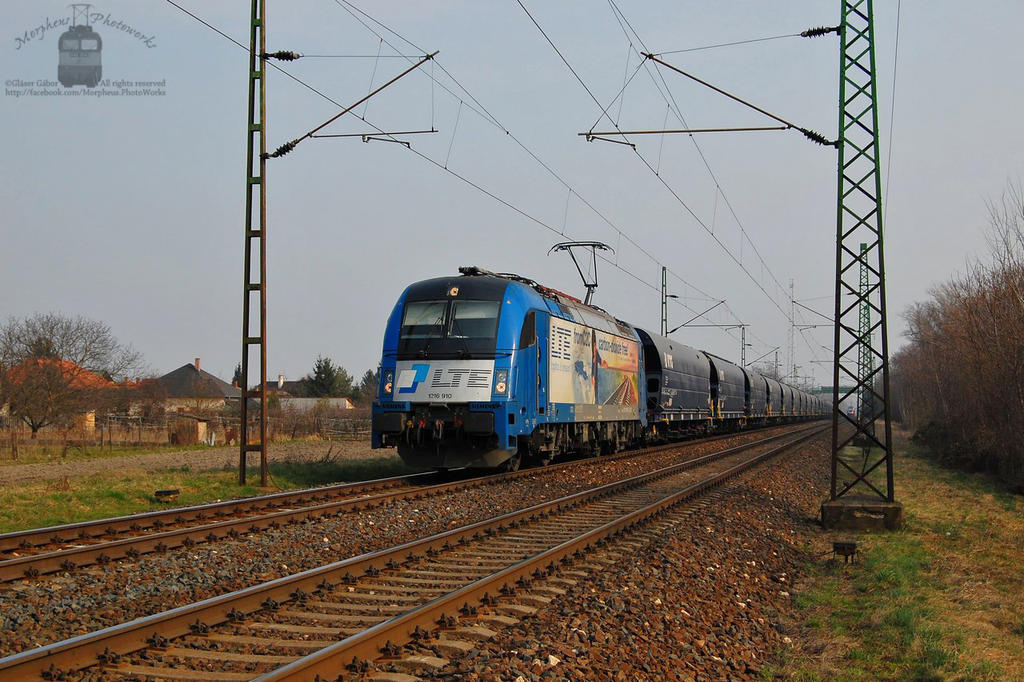1216 910 with a freight train near Abda by morpheus880223