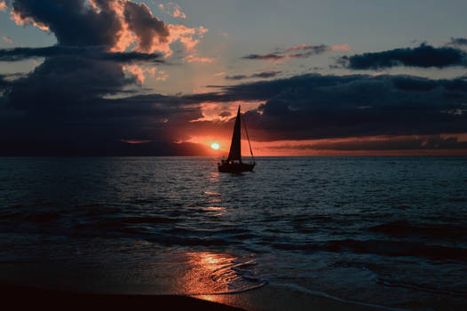 Silhouette of sailboat on body of water during sun