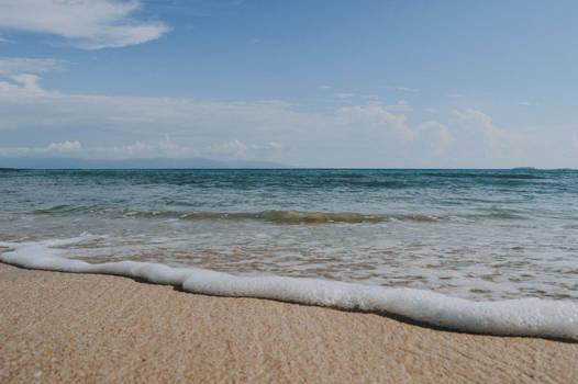 Seashore under blue sky at daytime