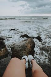 Sitting on rocks by friabrisa