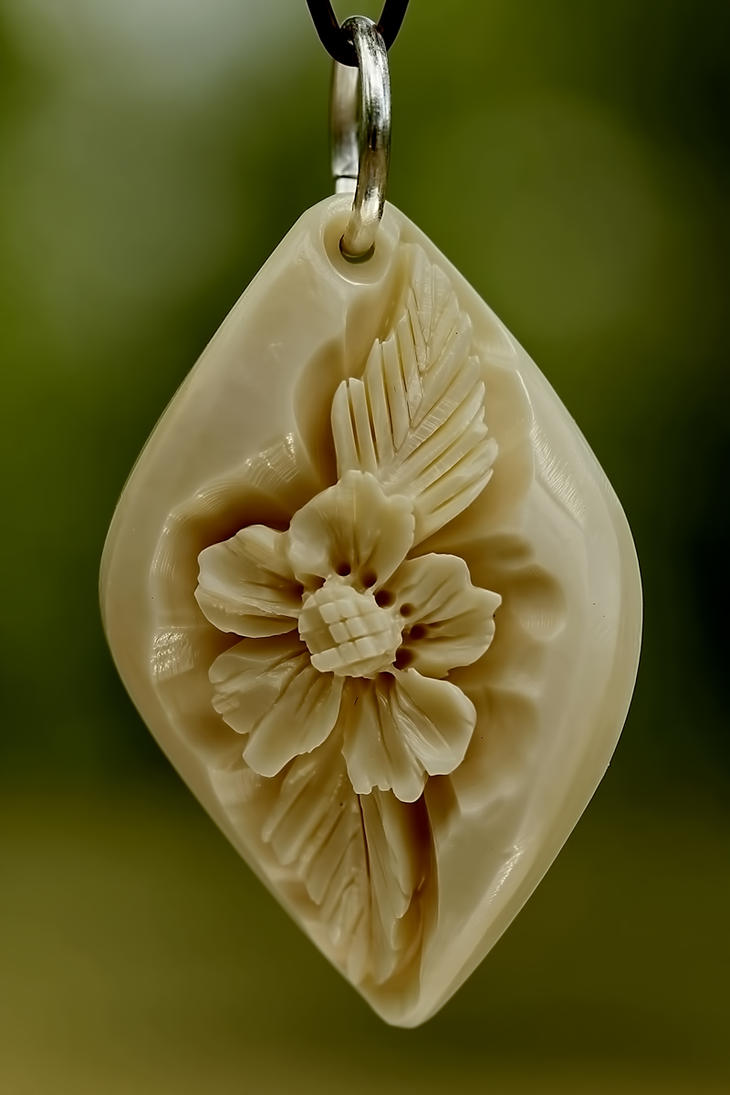 pendant 1 - bone carving by manuroartis